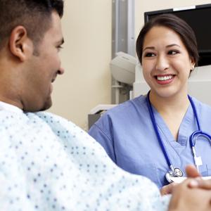 Nurse talking to non English-speaking patient