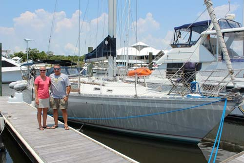 Travel nurse Tina Stines, her husband, Doug, and their sailboat, Pieridae
