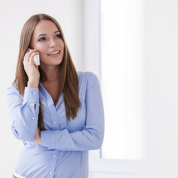 travel nurse interview - featured image of happy nurse on a phone interview