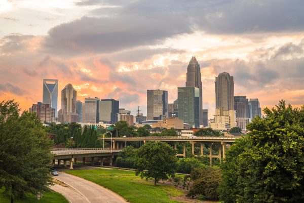 travel nursing locations - 15 places to see before you die - image of north carolina skyline and sunset