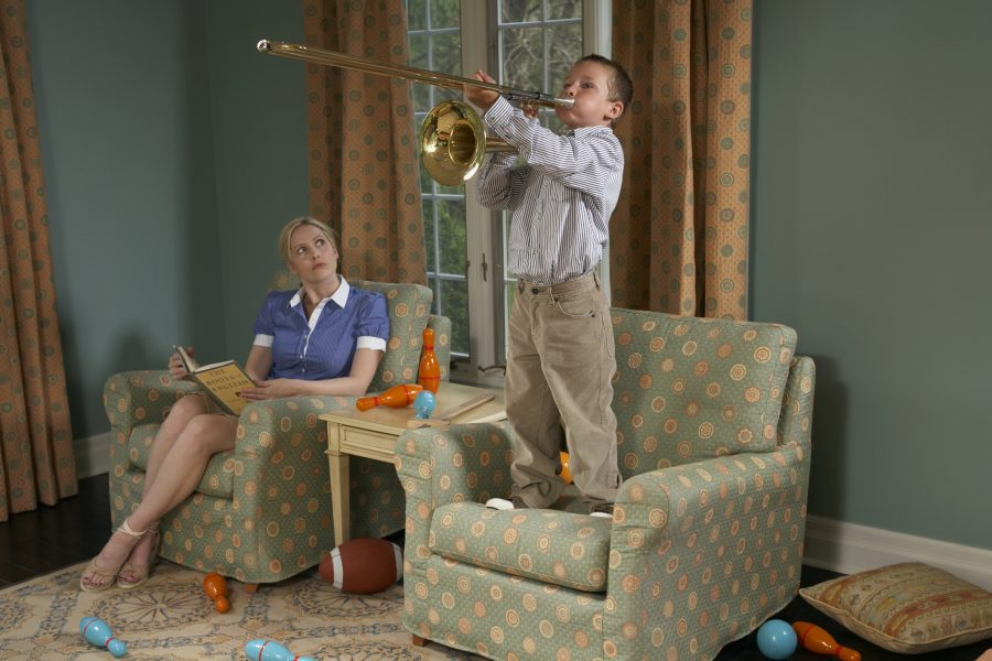 RNnetwork - working with difficult people - featured image of boy annoying mother with loud trombone