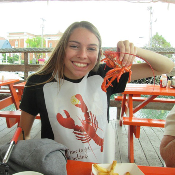 Travel nurse enjoying lobster in Maine
