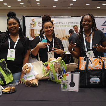 Travel nurses with swag at TravCon