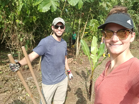 Two people working in the jungle