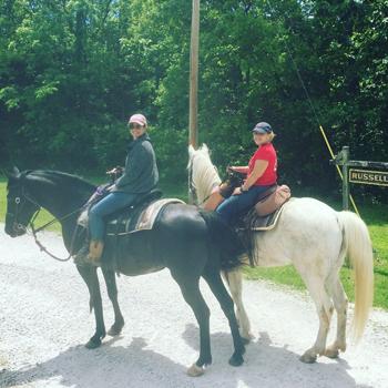 Two people on horseback