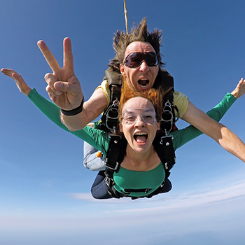 Two women tandem skydiving