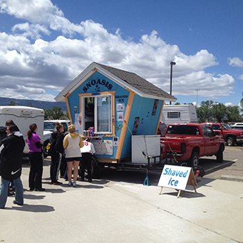 Shave ice shack with people standing in line