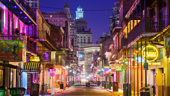 Brightly lit street in New Orleans at night