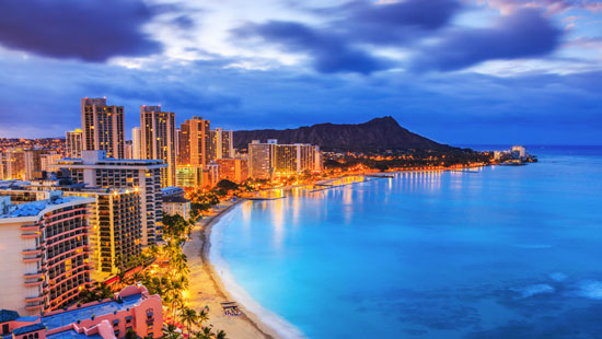 Landscape photo of Honolulu and bay at night