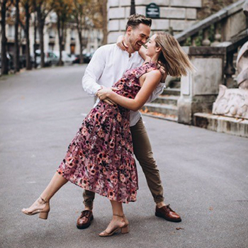 Man embracing a woman on the street