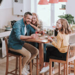 Family seated at kitchen table