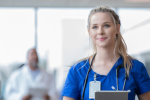 Young female nurse learning how to get started in travel nursing as a new graduate