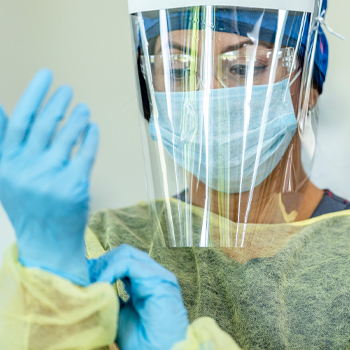 Nurse in PPE wearing a faceshield
