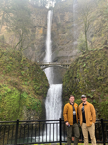 Twin brothers and waterfall